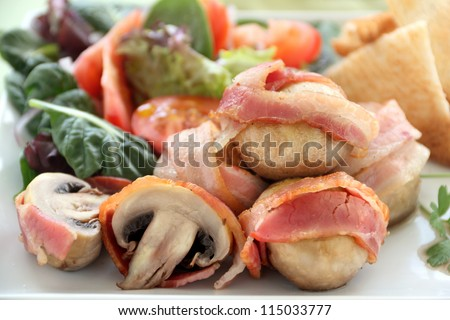 Delicious whole mushrooms wrapped in bacon strips ready to serve.