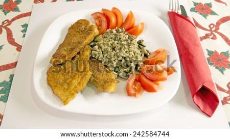 Delicious Wiener Schnitzel with lemon and tomatoes - stock photo
