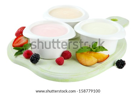 Delicious yogurt with fruit and  berries isolated on white - stock photo