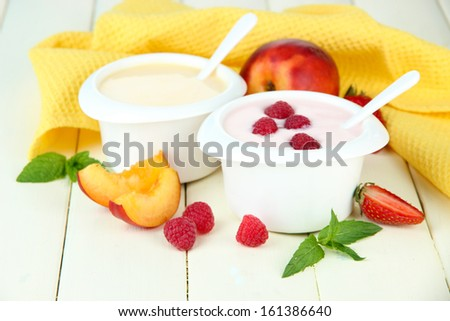 Delicious yogurt with fruit and berries on table close-up - stock photo