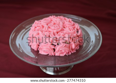 Deliciously Decorated Pink Rose Cake On A Glass Plate - stock photo