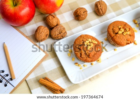 Delicius muffins with apple, chest nut and cinnamon - stock photo