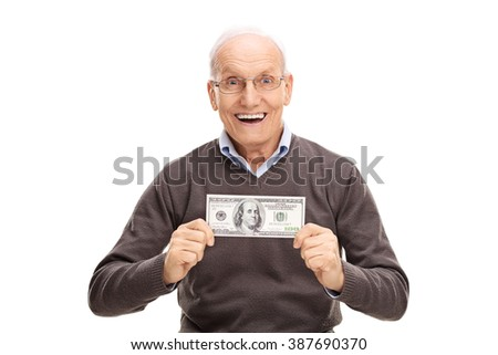 Delighted senior gentleman holding a hundred dollar bill and smiling isolated on white background - stock photo