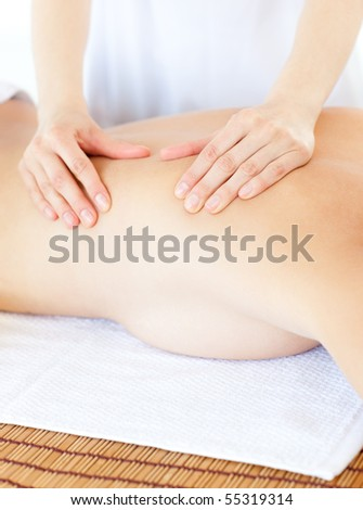 Delighted woman having a massage with massage oil in a spa