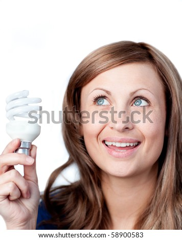 Delighted woman holding a light bulb against white background - stock photo