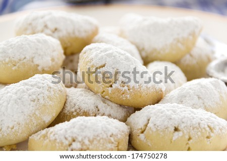 Delightful fresh baked Kourabiedes which is a Greek butter cookie wth icing sugar. - stock photo