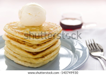 Delightful heart shaped pancakes served with vanilla ice cream and maple syrup.