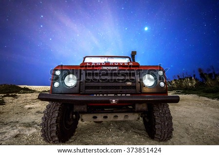 DELIMARA, MALTA - FEBRUARY 6, 2016: The Land Rover Defender, now out of production, will remain the adventurous' favourite vehicle for many years to come - stock photo