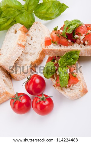deliscious fresh bruschetta appetizer with tomatoes isolated on white background