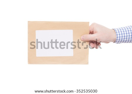 Delivering of letter to recipient (only one hand and parcel seen) - stock photo
