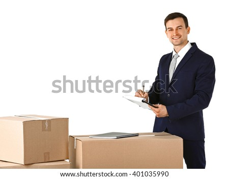 Delivery concept. Man in black suit with carton boxes isolated on white background - stock photo