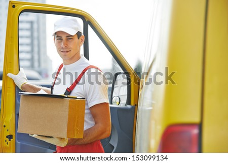 delivery courier man in front of cargo van delivering package carton box - stock photo