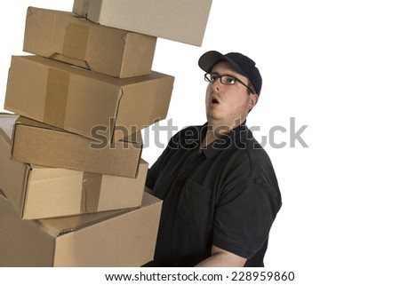 delivery driver in blue uniform with an overturning pile of parcels isolated on white background - stock photo