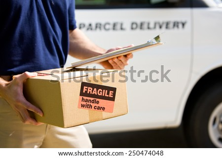 Delivery: Focus on Cardboard Box with Label - stock photo