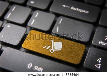 Delivery key with shipping cart icon on laptop keyboard. Included clipping path, so you can easily edit it. - stock photo