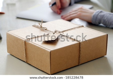 Delivery, mail. Package on the table - stock photo