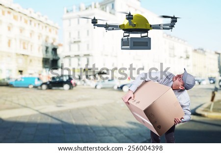 delivery man and modern drone - stock photo