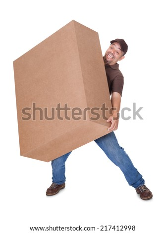 Delivery Man Carrying Heavy Box On White Background - stock photo