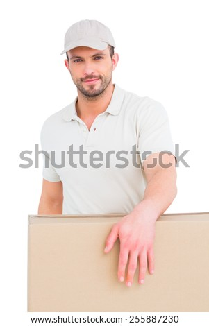 Delivery man carrying package on white background - stock photo