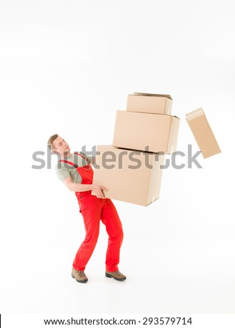 delivery man carrying pile of boxes and dropping some of them, isolated on white background - stock photo