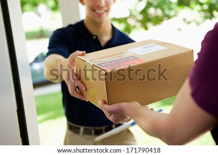 Delivery: Man Delivering Package To Homeowner - stock photo
