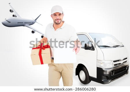 Delivery man giving clipboard for signature against graphic airplane - stock photo