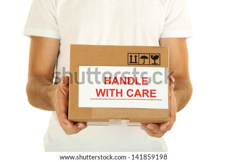 Delivery man holding parcel, isolated on white - stock photo