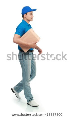 delivery man in blue uniform sending a package - stock photo