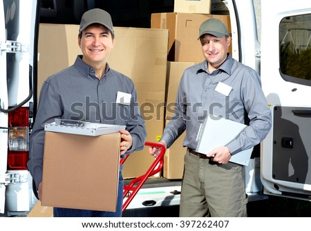 Delivery man near shipping truck.