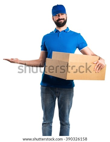 Delivery man presenting something - stock photo