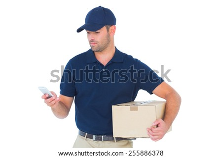 Delivery man using mobile phone while holding package on white background - stock photo