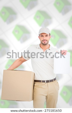 Delivery man with cardboard box showing clipboard against green roofed 3d houses - stock photo