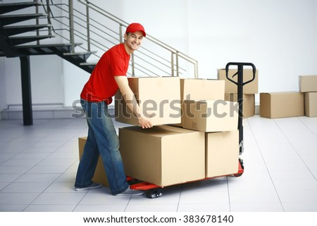 Delivery man with hand truck, close up - stock photo