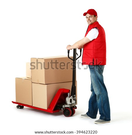 Delivery man with hand truck isolated on white background - stock photo
