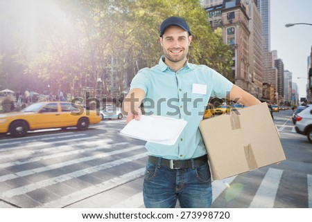 Delivery man with package giving clipboard for signature against new york street - stock photo