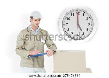 Delivery man writing on clipboard against five o clock - stock photo