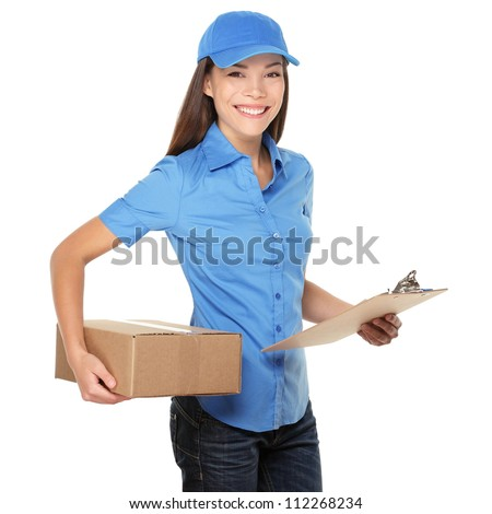 Delivery person delivering packages holding clipboard and package smiling happy in blue uniform. Beautiful young mixed race Caucasian / Asian woman professional courier isolated on white background