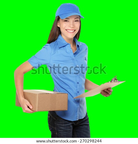 Delivery person delivering packages holding clipboard and package smiling happy in blue uniform. Beautiful young Caucasian Chinese Asian female courier. Isolated on green screen chroma key background.