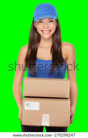 Delivery person holding packages wearing blue cap. Woman courier smiling happy isolated on green screen chroma key background.. Beautiful young mixed race Caucasian / Chinese Asian female professional