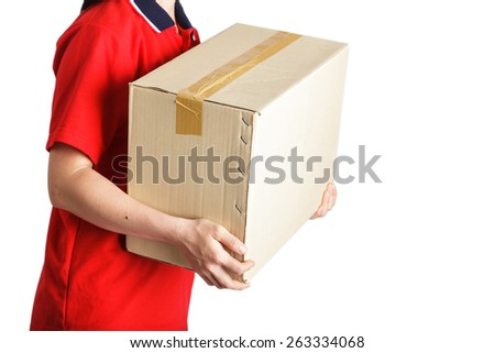 Delivery woman holding cardboard box  - stock photo