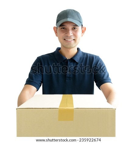Deliveryman giving a cardboard parcel box - stock photo