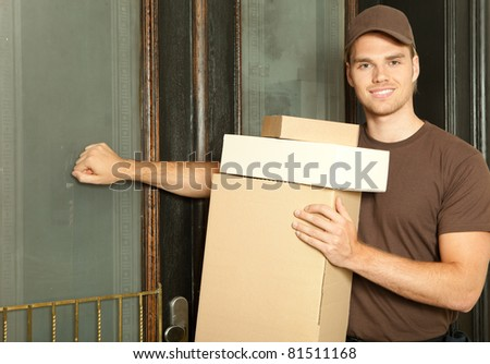 deliveryman knocking at the door - stock photo