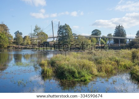 Delta Oaks wetland park in Eugene Oregon with a bike bridge in the background - stock photo
