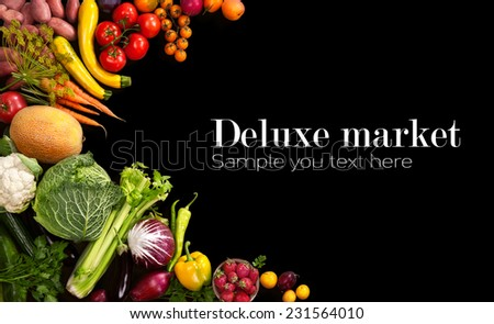 Deluxe market / studio photo of different fruits and vegetables on black backdrop  - stock photo