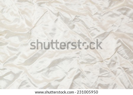 Deluxe silk cloth background with waves and drapery. Backdrop for fashion luxury design - stock photo