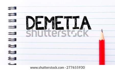 Dementia Text written on notebook page, red pencil on the right. Concept image