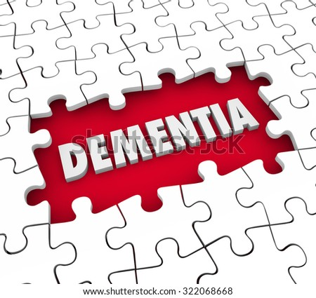 Dementia word in a hole with puzzle pieces to illustrate aging, memory loss, mind or brain degeneration and medical treatment for the condition - stock photo