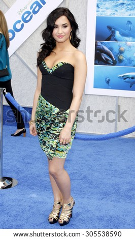 Demi Lovato at the Los Angeles premiere of 'Oceans' held at the El Capitan Theater in Hollywood, USA on April 17, 2010. - stock photo
