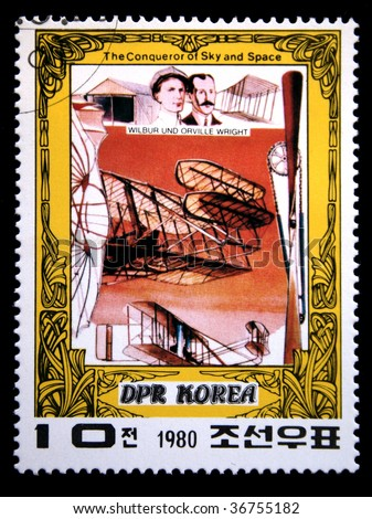 DEMOCRATIC PEOPLE'S REPUBLIC (DPR) of KOREA - CIRCA 1980:A stamp printed in DPR Korea (North Korea) shows Wright brothers and their plane, a stamp from series The Conqueror of Sky and Space,circa 1980 - stock photo