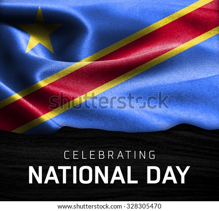 Democratic Republic of the Congo flag and Celebrating National Day Typography on wood background - stock photo